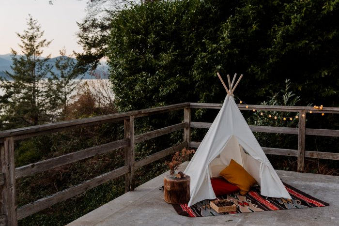 wigwam placed on wooden terrace with picturesque view